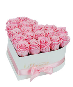 heart shaped baby pink roses in a white box