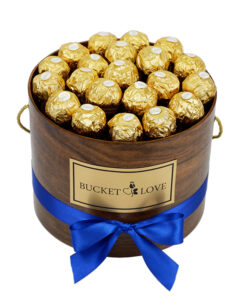 ferrero roche box of chocolate in a wodden brown box with blue bow