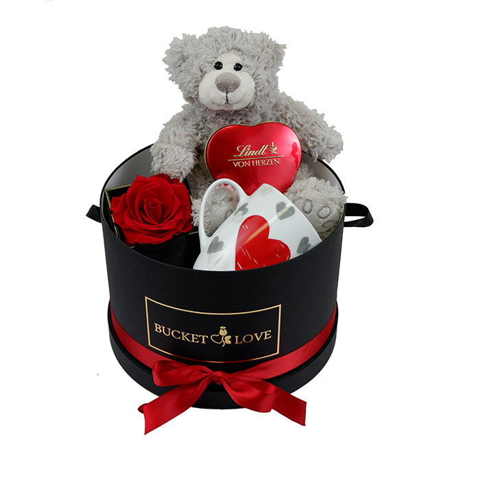 grey teddy bear with red heart of chocolates and red rose and white