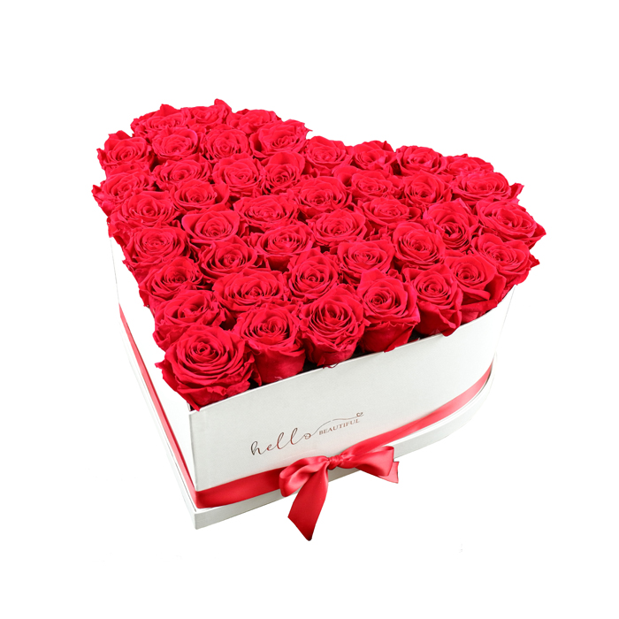 red roses in the box of the shape of the heart in white box