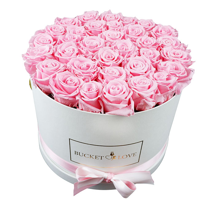 dozens of flowers in a boxed bouquet