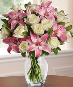 A bunch of pink lilies in white